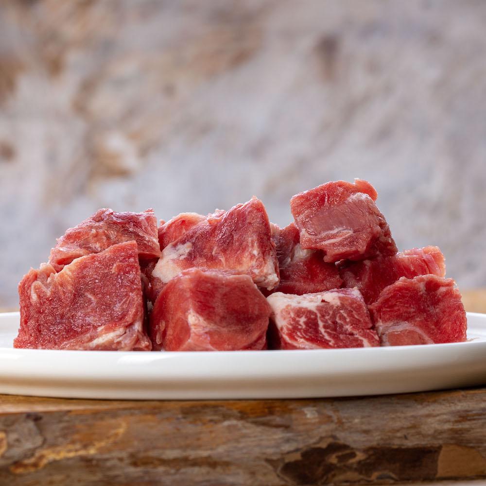 Barfgold Ziegenmuskelfleisch, durchwachsen gefroren, gewürfelt 1000g